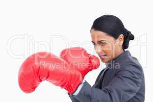 Close up side view of aggressive saleswoman with boxing gloves