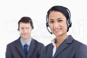 Close up of smiling call center agents