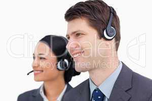 Close up of smiling call center team