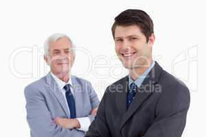 Close up of smiling businessman with his mentor behind him