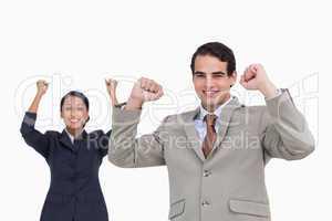 Cheering salesman with colleague behind him