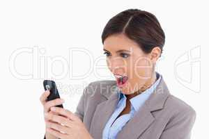 Close up of female entrepreneur surprised by text message