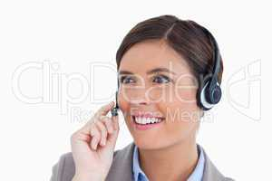 Close up of smiling female call center agent with headset