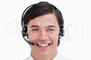 Close up of smiling male call center agent with headset on
