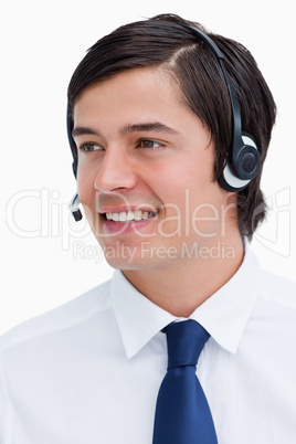 Close up of smiling male call center agent looking to the side