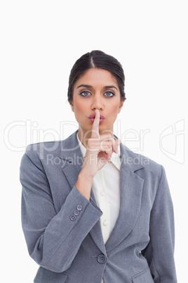 Close up of female entrepreneur asking for silence