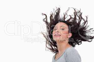 Sensual looking woman flipping her hair