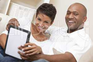 African American Man Woman Couple Using Tablet Computer