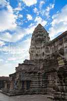 Tower in Angkor Wat temple with blue sky and clouds