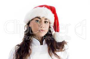 young chef wearing christmas hat and looking at camera