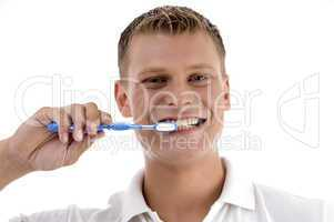 healthy male cleaning his teeth