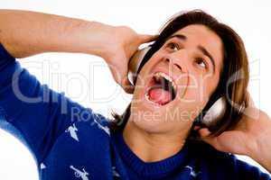 portrait of shouting male enjoying music