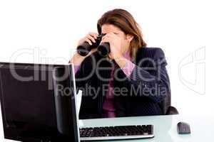 portrait of businessman looking monitor through binocular