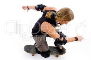 male in action on skateboard