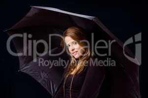 portrait of smiling female holding umbrella