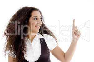 hispanic female pointing upwards