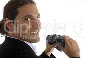 cheerful handsome lawyer holding a pair of binoculars