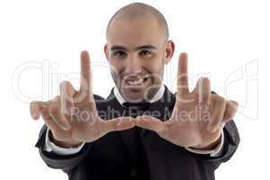 young corporate man posing hands like frame