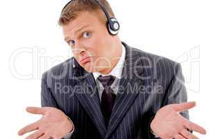 confused businessman posing with headset