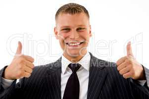 portrait of pleased businessman with thumbs up