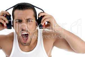 caucasian guy enjoying rock music with full volume