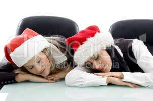 young corporate wearing christmas hat and sleeping