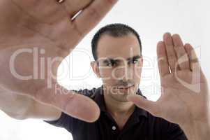 smart pose of young guy with open palms