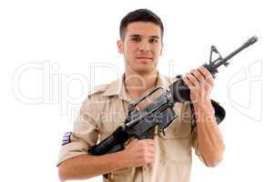 smiling soldier posing with gun