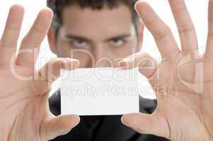 businessman holding his visiting card