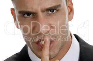 businessman shushing with close up pose
