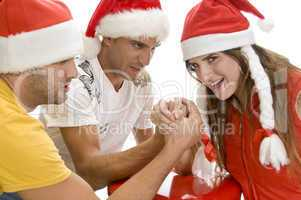 young people doing arm wrestling