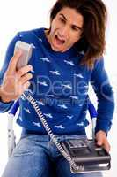 front view of angry man shouting on phone