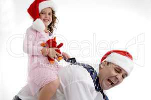 little girl sitting on her father's back