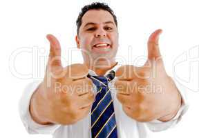 executive with goodluck hand gesture
