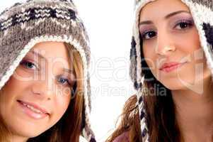 two young friends wearing woolen cap and looking at camera