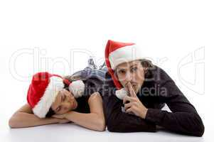 cute girl sleeping and guy indicating for silent