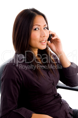 young female service provider busy on cell phone