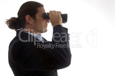 young caucasian service provider looking through binoculars