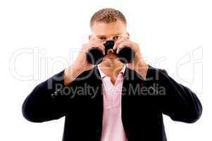 portrait of businessman with binocular