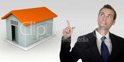 business man gesturing with hand and three dimensional house