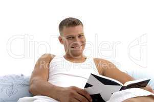 smart male reading book with great interest