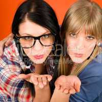 Two woman friends young send kiss