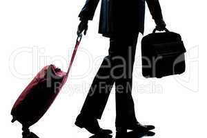 business traveler man walking with handbag and  suitcase