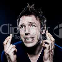 Funny Man Portrait with crossed fingers