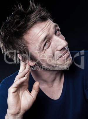 Funny Man Portrait with hearing problem