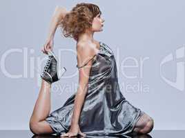 beautiful young girl with prom dress supple stretching