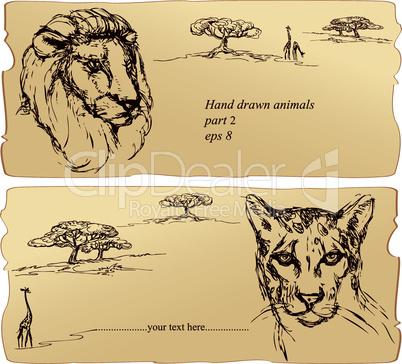 Lion and cheetah heads.