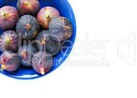 Bowl of ripe figs isolated on white
