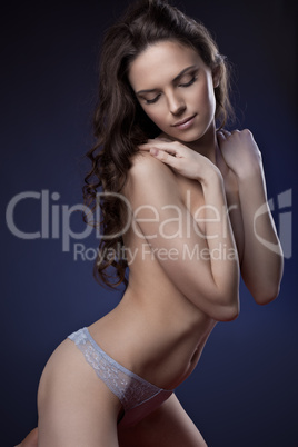 Young sexy woman posing in panties