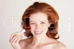 Smiling Woman Applying Blusher
